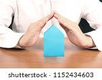 mortgage concept by house from... | Shutterstock . vector #1152434603