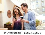 couple using mobile phone and... | Shutterstock . vector #1152461579