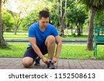 sport man tying jogging shoes... | Shutterstock . vector #1152508613