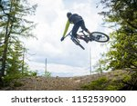 rear shot of a mountainbiker... | Shutterstock . vector #1152539000