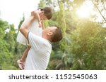 asian family outdoors portrait. ... | Shutterstock . vector #1152545063