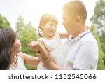 happy parents and child bonding ... | Shutterstock . vector #1152545066