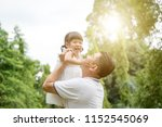 asian family outdoors portrait. ... | Shutterstock . vector #1152545069