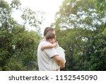 asian family outdoors portrait. ... | Shutterstock . vector #1152545090