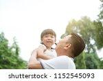 asian family outdoors portrait. ... | Shutterstock . vector #1152545093