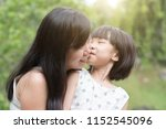 little girl kissing mother at... | Shutterstock . vector #1152545096