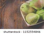 fresh pears in a wattled box... | Shutterstock . vector #1152554846