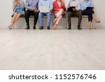 group of young people waiting... | Shutterstock . vector #1152576746