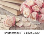 Pink Roses And Old Books On...