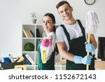 happy young cleaners with mop... | Shutterstock . vector #1152672143