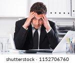 frustrated businessman sitting... | Shutterstock . vector #1152706760