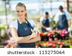 pretty female florist portrait... | Shutterstock . vector #115275064