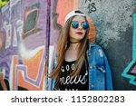 stylish casual hipster girl in... | Shutterstock . vector #1152802283