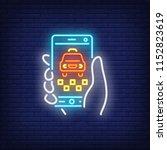 ordering taxi online neon sign. ... | Shutterstock .eps vector #1152823619