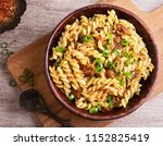 delicious pasta with beef in... | Shutterstock . vector #1152825419