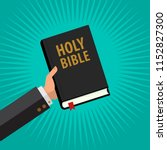 man hold holy bible in his hand ... | Shutterstock .eps vector #1152827300