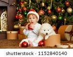 Stock photo boy with samoyed puppy christmas 1152840140