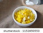 boiled corn in whit bowl ... | Shutterstock . vector #1152850553