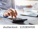 accountant working on desk... | Shutterstock . vector #1152854930
