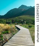 alpine mountain house path... | Shutterstock . vector #1152859313