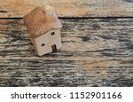 miniature house on wooden table. | Shutterstock . vector #1152901166