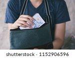 girl's hands holding baht bills ...   Shutterstock . vector #1152906596