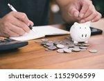 saving money concept man hand...   Shutterstock . vector #1152906599