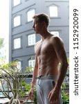 handsome shirtless muscular man ... | Shutterstock . vector #1152920099
