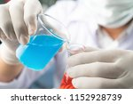 chemist student boy pouring... | Shutterstock . vector #1152928739