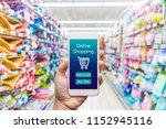 men hand holding modern mobile... | Shutterstock . vector #1152945116