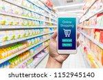 men hand holding modern mobile... | Shutterstock . vector #1152945140