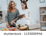 smiling mother and daughter... | Shutterstock . vector #1153000946