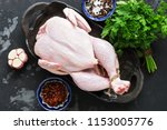 whole raw chicken close up on a ... | Shutterstock . vector #1153005776