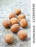 walnuts on stony background | Shutterstock . vector #1153045940