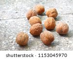 walnuts on stony background | Shutterstock . vector #1153045970