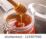 honey drip in jar on the table | Shutterstock . vector #115307500