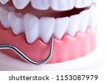 dentist cleaning teeth with... | Shutterstock . vector #1153087979