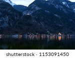 Unique view of famous Hallstatt mountain village in the Austrian Alps at night. Beautiful view on the other side of the shore. Salzkammergut region, Hallstatt, Austria. Neutral colors.