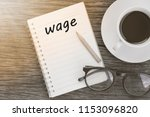 wage word on notebook with...   Shutterstock . vector #1153096820