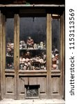 roman shopwindow with old dolls ...   Shutterstock . vector #1153113569