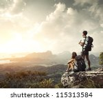 Hikers With Backpacks Enjoying...