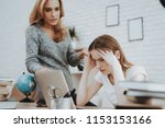angry mother motivate daughter... | Shutterstock . vector #1153153166