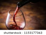 red wine is poured | Shutterstock . vector #1153177363