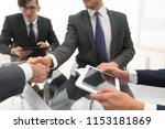 two businessmen handshaking ... | Shutterstock . vector #1153181869