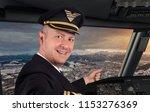 joyful pilot in cockpit | Shutterstock . vector #1153276369