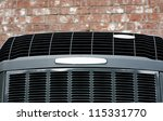 Close up shot of high High efficiency modern AC-heater unit on brick wall background - stock photo