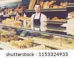 smiling baker demonstriruet... | Shutterstock . vector #1153324933