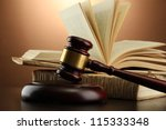 wooden gavel and books on... | Shutterstock . vector #115333348