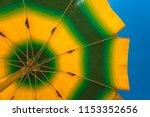 beach umbrella shot from below... | Shutterstock . vector #1153352656