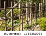 A Long  Rustic Bamboo Fence At...